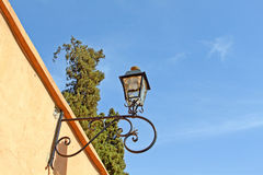 Old street lamp. On a red wall Royalty Free Stock Image