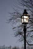 Old street lamp against dramatic blue sky Royalty Free Stock Images