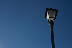 Old street lamp and blue sky. Street lamp in a nice sky Royalty Free Stock Photo
