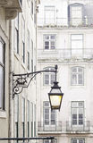 Old street lamp on a classical facade in Lisbon Stock Photos