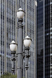 Old street lamp in constrast with modern lines. SAO PAULO, SP, BRAZIL - MAY 23, 2015 - Old street lamp, symbol of Sao Paulo, in contrast with modern lines of the stock images