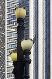 Old street lamp in constrast with modern lines. SAO PAULO, SP, BRAZIL - MAY 23, 2015 - Old street lamp, symbol of Sao Paulo, in contrast with modern lines of the royalty free stock photos
