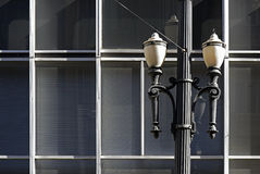 Old street lamp in constrast with modern lines. SAO PAULO, SP, BRAZIL - MAY 23, 2015 - Old street lamp, symbol of Sao Paulo, in contrast with modern lines of the stock photos