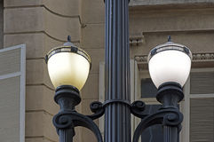 Old street lamp in constrast with modern lines. SAO PAULO, SP, BRAZIL - MAY 23, 2015 - Old street lamp, symbol of Sao Paulo, in contrast with modern lines of the royalty free stock image