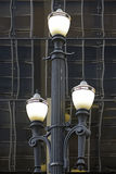 Old street lamp in constrast with modern lines. SAO PAULO, SP, BRAZIL - MAY 23, 2015 - Old street lamp, symbol of Sao Paulo, in contrast with modern lines of the stock photography