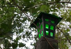 Old street lamp with a dim green light royalty free stock photos
