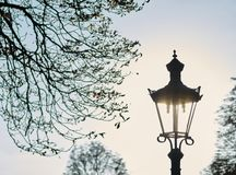 Old street lamp. Before an evening sky Royalty Free Stock Images