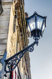 Old street lamp. Fixed to Delft city hall building, Netherlands Stock Photo