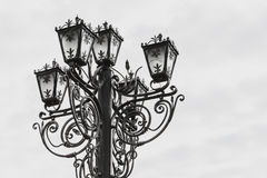 Old street lamp. A forged street lamp on a white background. Old street lamp. A forged street lamp on a white background Stock Images