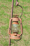 Old street lamp isolated hanging on rust steel Royalty Free Stock Photo