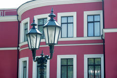 Old street lamp. Street light on the background of the theater Stock Images