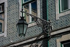 Old street lamp and lisbon traditional tiles facade. Lisbon, Portugal Stock Images