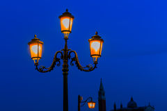 Old street lamp at night in Venice, Italy Stock Photo