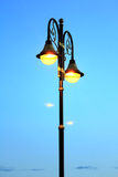 Old street lamp pole Stock Images