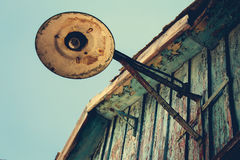 Old street lamp on roof. Royalty Free Stock Photography