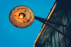 Old street lamp on roof. Stock Images