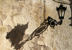 Old street lamp. With shadow in the streets of Ronda, Spain royalty free stock photography