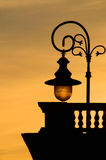 The old street lamp silhouette. The old street lamp evening silhouette shooted in the old Warsaw (Poland Royalty Free Stock Photo