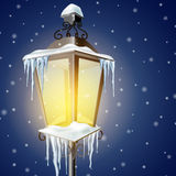 Old street lamp in snow Royalty Free Stock Photo