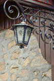 An old street lamp on a stone wall Stock Image