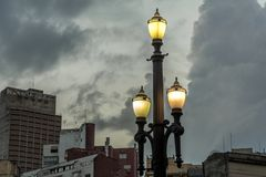 Old street lamp, symbol of the city of Sao Paulo, Brazil, in fro. Old vintage street lamp, symbol of the downtown of the city of Sao Paulo, Brazil, in front of stock photography