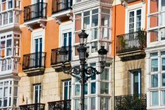 Old street lamp with typical spanish houses in the background. Santander, Spain stock photo