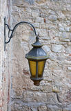 Old street lamp on a wall. In castle Royalty Free Stock Photo