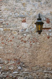 Old street lamp on a wall. In castle Stock Image
