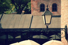 Old street lamp on the wall at noon with vintage effect background Royalty Free Stock Photo