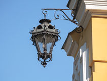Old street lamp on the wall of the temple Royalty Free Stock Photo