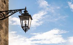 Old street lamp in wrought iron. Old street lamp in wrought iron with copy space Stock Photography
