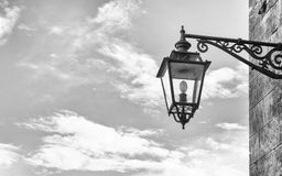 Old street lamp in wrought iron. Royalty Free Stock Photo