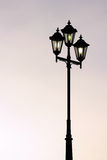 Old street lamppost against twilight background Royalty Free Stock Photos