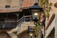 Old street lamps illuminate the way for passersby royalty free stock photography