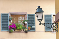 Old street lamps with windows in the background, Strasbourg, France Stock Photo
