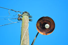 Old street lantern. Old street electric lantern with rusted light reflector stock image