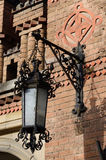 Old street lantern on the brick wall ,Chernivtsi University,Ukraine Royalty Free Stock Photography