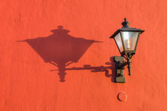 Old street lantern on the wall with shadow Royalty Free Stock Photos
