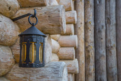 Old street light closeup on wooden wall Royalty Free Stock Image
