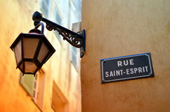 Old street light in french city during sunshine Stock Image