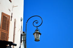 Old street light in french city during sunshine Royalty Free Stock Images