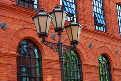 Old street light lamp post in Manufactura. Beuatiful old street light lamp post of historicPoznanski factory in restored shopping centre-Manufactura in Lodz ( Royalty Free Stock Photo