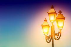 Old Street light on sky background. Light in the lantern. Space. For text Stock Photo