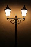 Old street lights. In a dark night stock images