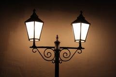 Old street lights. In a dark night stock photos