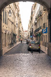 Old street in Lisbon downtown. Royalty Free Stock Photos