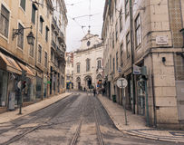 Old street in Lisbon downtown. Stock Photos