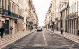 Old street in Lisbon downtown. Royalty Free Stock Images