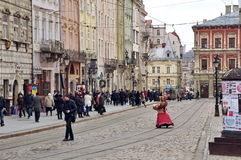 Old street, medieval architecture, passers-by Royalty Free Stock Photos