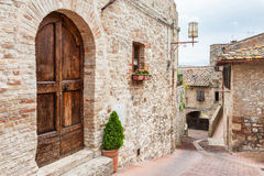 Old street in medieval town San Gimignano, Italy Stock Image